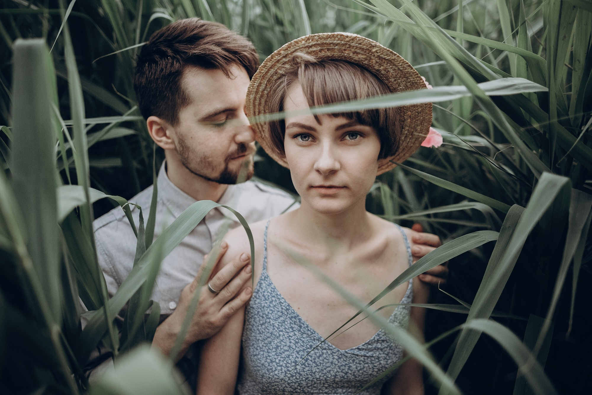 stylish-rustic-bride-and-groom-embracing-in-windy-high-reed.jpg